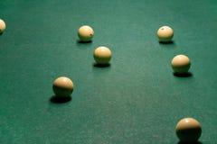 Billiard balls on a green pool table royalty free stock photos