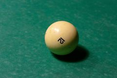 Billiard balls on a green pool table royalty free stock image