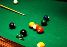 Billiard balls on green table Stock Photo