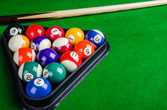 Billiard balls on green table with billiard cue, Snooker, Pool. Billiard balls on green table with billiard cue, Snooker, Pool game Stock Photos