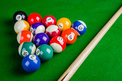 Billiard balls on green table with billiard cue, Snooker, Stock Photo