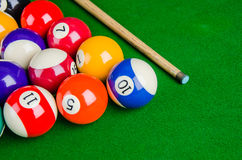 Billiard balls on green table with billiard cue, Snooker, Royalty Free Stock Image