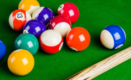 Billiard balls on green table with billiard cue, Snooker, Pool. Billiard balls on green table with billiard cue, Snooker, Pool game Stock Photography