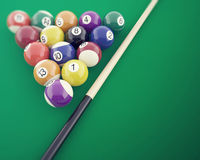Billiard balls on the green table, with cue. 3d illustration. Billiard balls on the green table, with cue, 3d illustration Royalty Free Stock Images