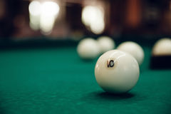 Billiard balls. On the green table, one is focused Stock Image