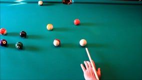 Billiard balls on the green table stock footage