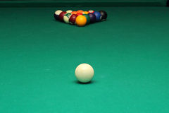 Billiard balls on green table and white ball Royalty Free Stock Photos