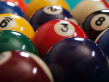 Billiard balls macro. Macro photo of a pool table and billiard balls. Shallow depth of field with focus on the three ball Stock Image