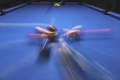 Billiard balls. In motion on blue table Stock Photography