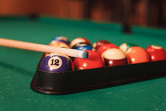 Billiard balls near by cue and chalk. Royalty Free Stock Photo