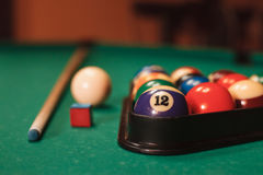Billiard balls near by cue and chalk. Stock Images