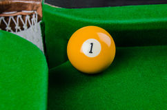 Billiard balls number 1 is going to fall Royalty Free Stock Images