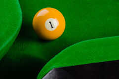 Billiard balls number 1 is going to fall Royalty Free Stock Image