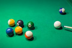 Billiard balls on pool green table stock photo