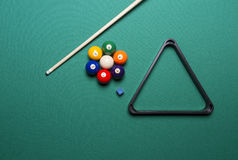 Billiard balls - pool. Seven billiard balls arranged in the shape of a flower; triangle; chalk; cue game Royalty Free Stock Photo