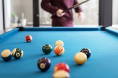 Billiard balls on a pool table Stock Images