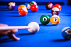 Billiard balls in a pool table. Billiard balls in a blue pool table Stock Images