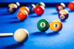 Billiard balls in a pool table. Billiard balls in a blue pool table stock photo