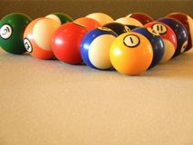 Billiard balls in a pool table Stock Images