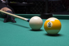 Billiard balls in a pool table. focus on the white ball. Billiard balls in a pool table Royalty Free Stock Images