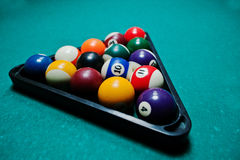 Billiard balls in a pool table at triangle Stock Photos