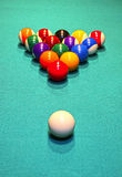 Billiard balls in the position of the pyramid on green baize Royalty Free Stock Photography