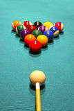 Billiard balls in the position of the pyramid on green baize Royalty Free Stock Image