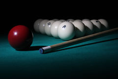 Billiard balls pyramid on light beam. Pool balls on light beam. Balls pyramid with number 8 ball on a foreground Stock Photography