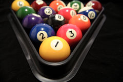 Billiard balls in rack. A closeup view of colorful billiard or pool balls in a plastic rack, ready to start the next game Royalty Free Stock Photo