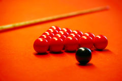 Billiard balls on a red cloth Stock Photos
