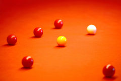Billiard balls on a red cloth Royalty Free Stock Images