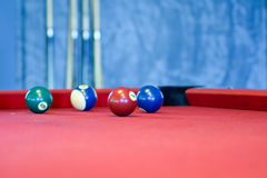 Billiard balls on a red pool table Royalty Free Stock Photo