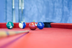 Billiard balls on a red pool table Stock Photo