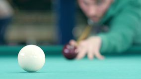 Billiard balls roll on the green table. Slow stock video footage