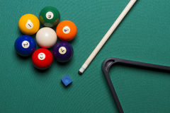 Billiard balls. Seven billiard balls arranged in the shape of a flower; triangle; chalk; cue game Royalty Free Stock Photos