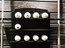 Billiard balls on the shelf with cues from both sides. Billiard balls for russian billiards, white balls for billiards on a wooden background. Close-up royalty free stock photos