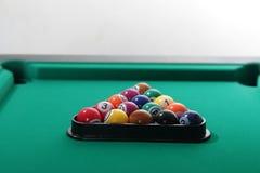 Billiard balls on table stock images