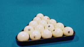 Billiard balls on a billiard table background pyramid. Russian biiliard game stock footage