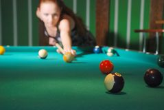 Billiard balls on table, blurred silhouette of cue Stock Photography