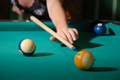 Billiard balls on table and cue aimed Stock Photos