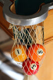 Billiard balls. Three billiard balls in the corner pocket, selective focus on number 5 Royalty Free Stock Image