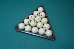 Billiard balls in the triangle. On the table Stock Images