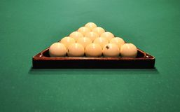 Billiard balls in wooden triangle royalty free stock photography