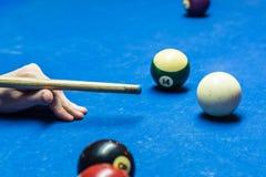 Billiard cue and balls Stock Photo