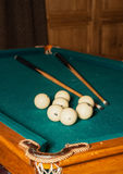 Billiard cue and balls on a green table Royalty Free Stock Images