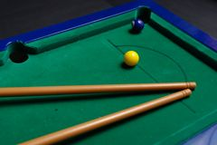 Billiard. Cue lying on green  table Stock Photography