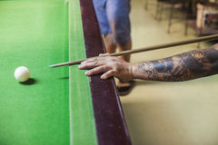 Billiard cue ready to hit white ball Stock Image