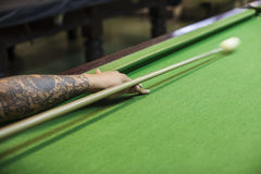 Billiard cue ready to hit white ball. Closeup of man hand with billiard cue ready to hit white ball stock photos