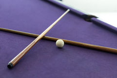 Billiard cues and white ball Stock Photo