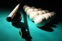 Billiard equipment. Billiard equipment on a table in light beam Royalty Free Stock Images